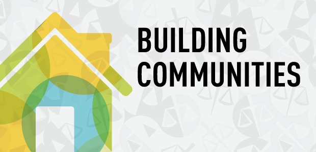 An illustration of a house and the text Building Communities