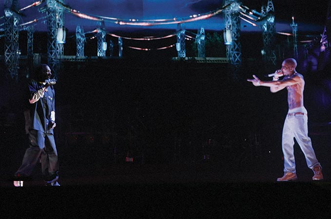 Image of performer Tupac appearing on stage as hologram