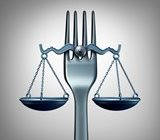 scales of justice balanced on a food fork