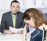 Woman at Job interview, looking dejected